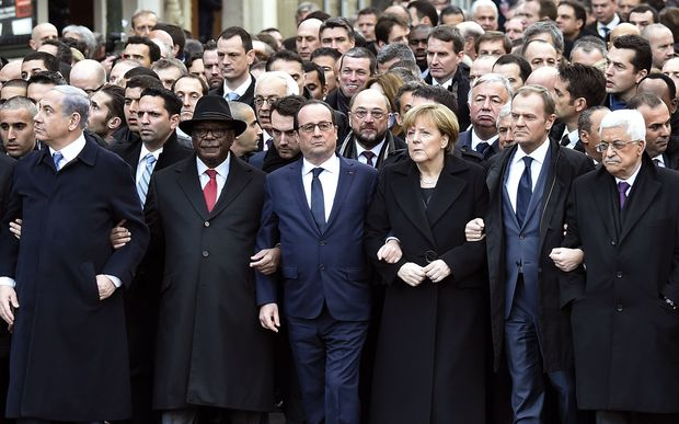 Israeli Prime Minister Benjamin Netanyahu (left), Malian President Ibrahim Boubacar Keita, French President Francois Hollande, German Chancellor Angela Merkel, EU President Donald Tusk and Palestinian president Mahmoud Abbas march in the unity rally.