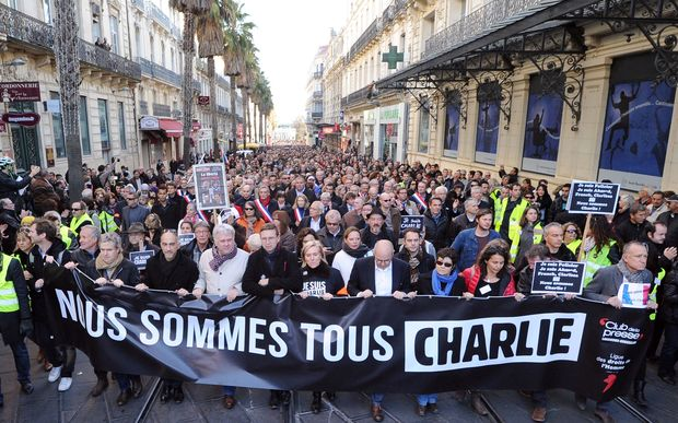 "Marchers in Montpellier hold a banner reading ""Nous sommes tous Charlie"" (We are all Charlie)."