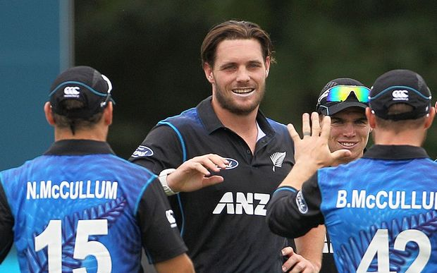 Mitchell McClenaghan of the Black Caps is congratulated by Nathan McCullum and Brendon McCullum during the first ODI cricket game between the Black Caps and Sri Lanka.