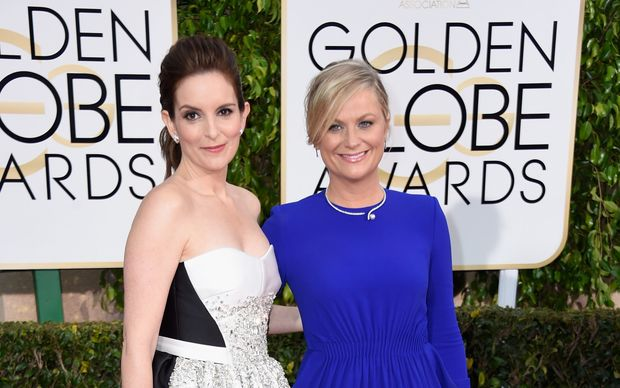 Golden Globes hosts Tina Fey (L) and Amy Poehler.