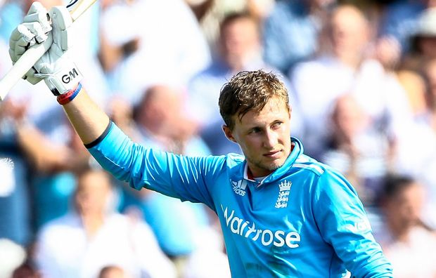 England cricketer Joe Root raises his bat.