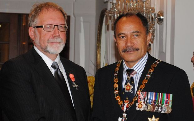 Dr John Angus (left) being awarded his New Zealand Order of Merit by Governor-General Sir Jerry Mateparae.