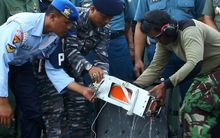 AirAsia QZ8501's Flight Data Recorder (FDR) is removed from its black box at the at Iskandar Airfield, Pangkalanbun, Indonesia after being retrieved from a depth of 30 to 32 meters in the Java Sea on January 12, 2015.