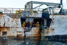 The New Zealand Defence Force says this photo shows fisherman hauling toothfish onboard the fishing vessel, Kunlun.