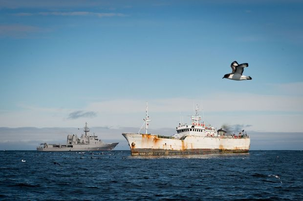 HMNZS Wellington (L) gathering evidence of illegal fishing in Antarctic waters.