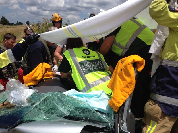 A woman had to be cut from her car following the crash.