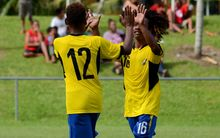Solomon Islanders Gershom Totori and Richard Raromo celebrate a goal at the Oceania U17 Championship.