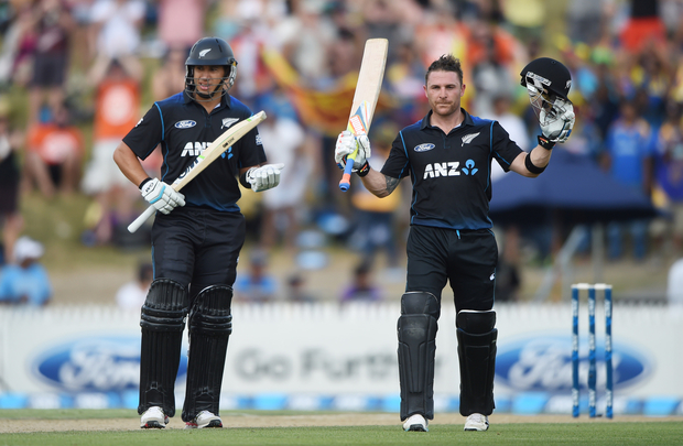 Black Caps' Brendon McCullum (R) celebrates his century as Ross Taylor looks on.