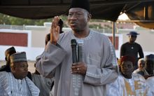 President Goodluck Jonathan speaks to displaced people from Baga in a Maiduguri camp on 15 January.
