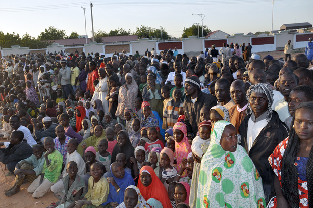 Displaced people from Baga listens to President Goodluck Jonathan (unseen) in a Maiduguri camp on 15 January.