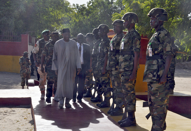 President Goodluck Jonathan inspects soldiers of the 7th Division of the Nigerian Army, which is fighting Boko Haram terrorists.