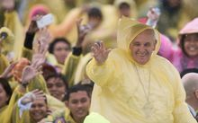 Pope Francis departed from the Philippines four hours earlier than scheduled due to Tropical Storm Mekkhala.