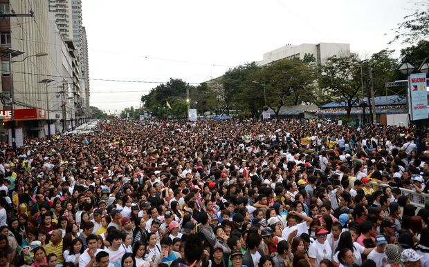 Thousands of people gather to wait for a mass to be celebrated by Pope Francis in Manila.