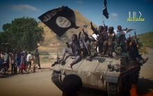 A screengrab taken on November 9, 2014 from a Boko Haram video released by the Nigerian Islamist extremist group Boko Haram and obtained by AFP shows Boko Haram fighters on a tank parading in an unidentified town.