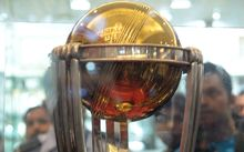 Indian fans look at the 2015 ICC Cricket World Cup trophy on display in Kolkata.