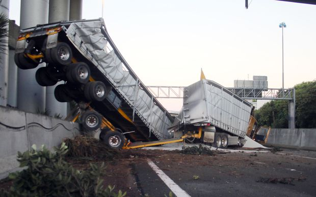 The truck and trailer unit plunged through a barrier at at Spagetti Junction on the Southern Motorway.