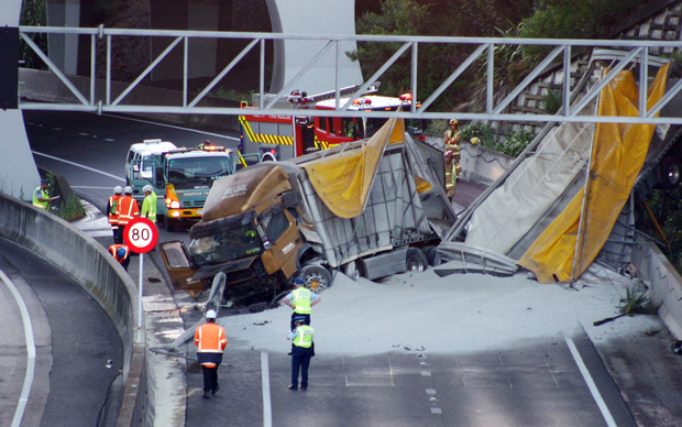 The truck and trailer unit plunged through a barrier at at Spaghetti Junction on the Southern Motorway.