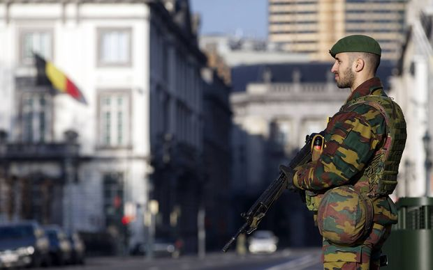 A Belgian soldier stands guard outside the US Embassy in Brussels on 17 January.