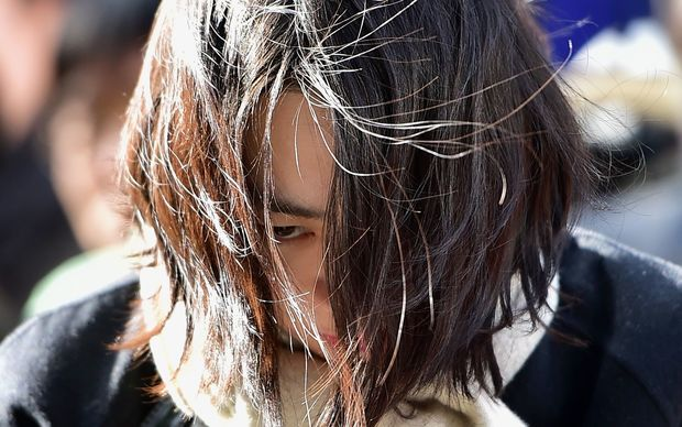 Heather Cho arrives for questioning at the prosecutors' office in Seoul in December