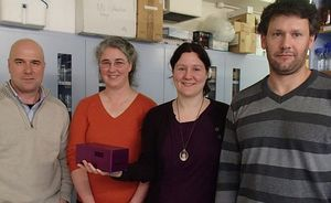 The team that have developed the Freedom4 mobile PCR device (from left): Chris Mason, Jo-Ann Stanton, Christy Rand (holding the device) and Chris Rawle.