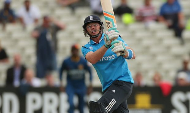 England cricket batsman Ian Bell hits a shot high into the air.