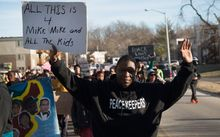 Demonstrators remember Michael Brown with a Martin Luther King Jr Day march on January 19, 2015.