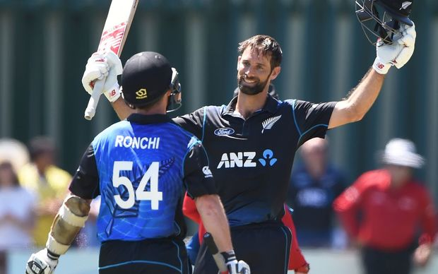 Grant Elliott celebrates his century with Luke Ronchi during the fifth ODI between New Zealand and Sri Lanka in Dunedin.