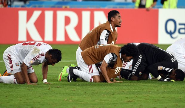 United Arab Emirates players celebrate their Asian Cup quarter-final win over Japan