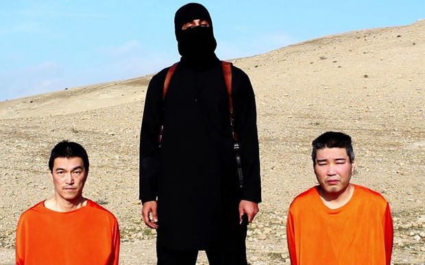 An image grab taken off a video on January 20, 2015, reportedly released by the Islamic State (IS) allegedly shows Japanese hostages Kenji Goto (L) and Haruna Yukawa (R).