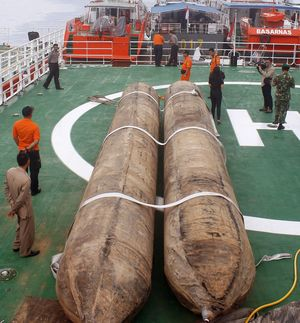 Giant lifting balloon bags are placed on the deck of the Indonesia's National Search And Rescue Agency n preparation for the recover of the fuselage of ill-fated AirAsia flight QZ8501.