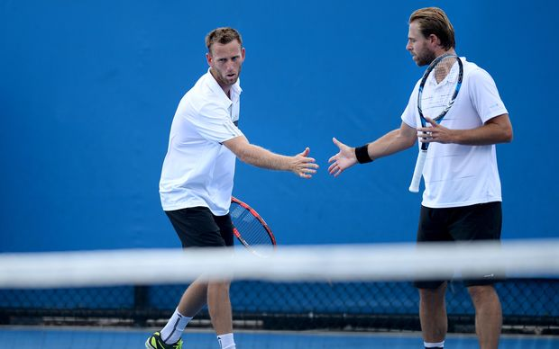 Michael Venus (left) celebrates a point with Oliver Marach