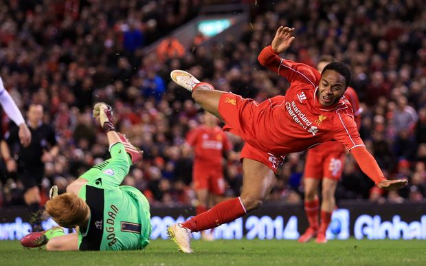 Liverpool winger Raheem Sterling comes off second-best to Bolton goalkeeper Adam Bogdan