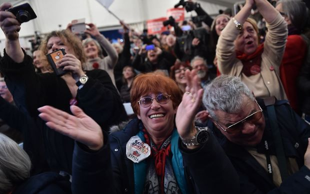 Anti-austerity Syriza supporters celebrate after the first exit polls in Athens on 26 January 2015.
