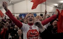 Anti-austerity Syriza supporters celebrate at the Syriza election kiosk in Athens in January 2015.