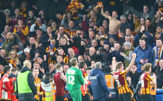 Bradford City players celebrate with their fans.