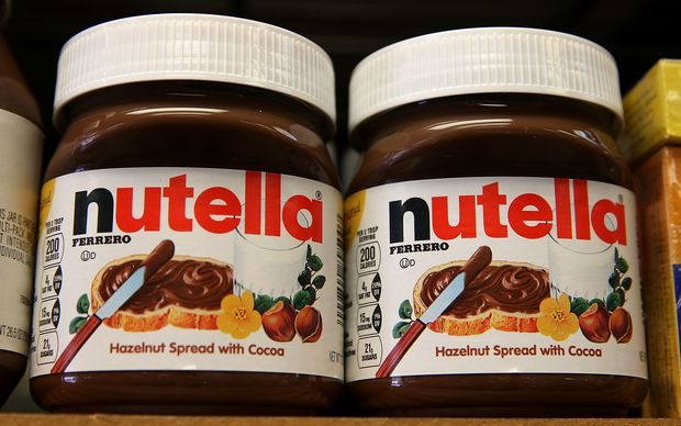 Jars of Nutella are displayed on a shelf at a market in San Francisco.