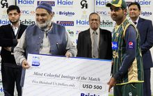 Pakistan allrounder Haris Sohail receives a prize for the most colourful innings during a one day match against New Zealand last year.