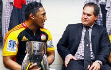 Bundee Aki and Dave Rennie celebrate in the dressing room after winning the 2013 Super Rugby Final.