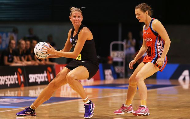 ANZ netball action 2014 Casey Kopua of the Magic and Nicola Mackle of the Tactix.