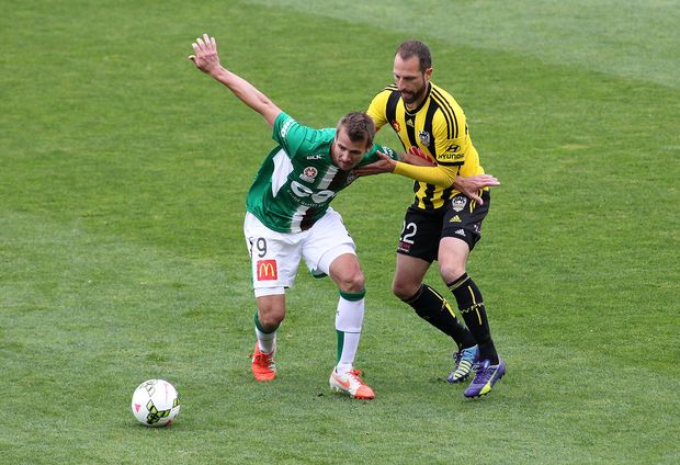 Jets' Joel Griffiths holds off the challenge from Phoenix' Andrew Durante during their A-League Football Match - Phoenix v Newcastle at the Westpac Stadium in Wellington on 26th of October 2014.