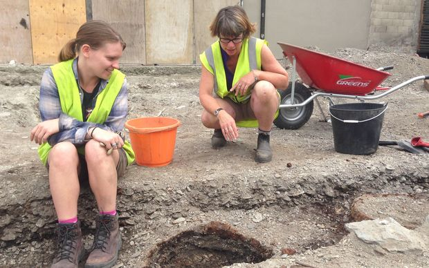 Archaeological PHD student Naomi Woods (left) and Dr Andrea Farminer study a trench containing six barrel hoops, which may be the former Eichardt's Hotel toilets.