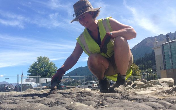 Archaeologist Dr Andrea Farminer brushes down the old Eichardt's Hotel stable floor.