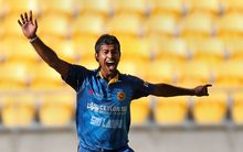 Nuwan Kulasekara celebrates the wicket of Martin Guptill.