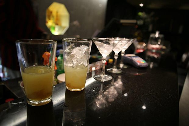 Line up of drinks on bar