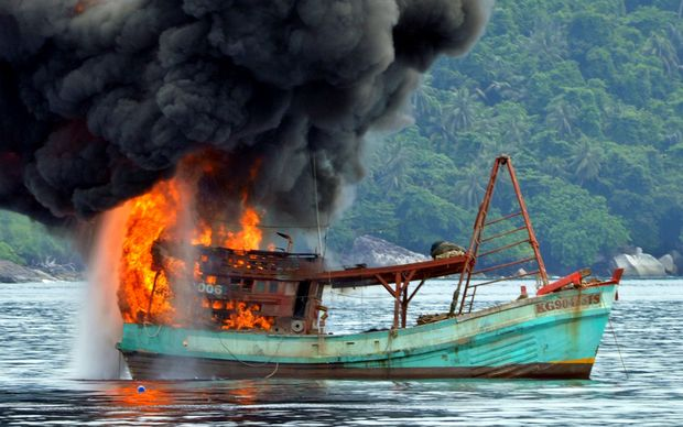 This picture shows a Vietnamese fishing boat in flames after Indonesian Navy officers blew up the vessel due to illegal fishing activities in the remote Anambas Islands.