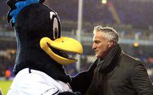 The former France footballer David Ginola meets the Tottenham Hotspur mascot.