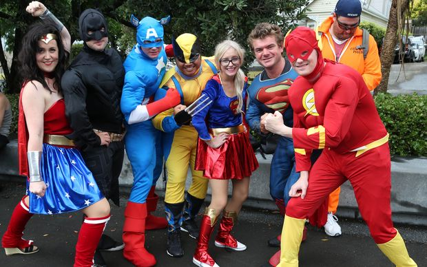 Fans dressed up as superheroes pose before heading into Eden Park for the NRL Nines