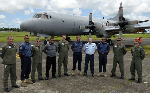 Members of the Fiji Navy and Ministry of Fisheries and New Zealand Air Force crew in front of the Orion.