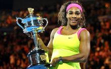 Serena Williams poses with the Australian Open trophy for the sixth time