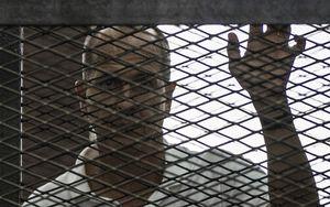 Al-Jazeera news channel's Australian journalist Peter Greste listens to the original court verdict in June.